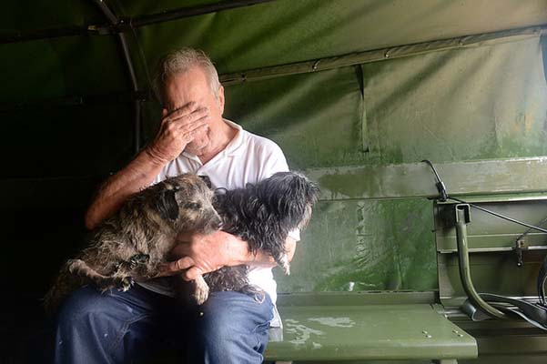 Crowdfunding can help survivors like this Texas man, who was rescued from the flood with his dogs